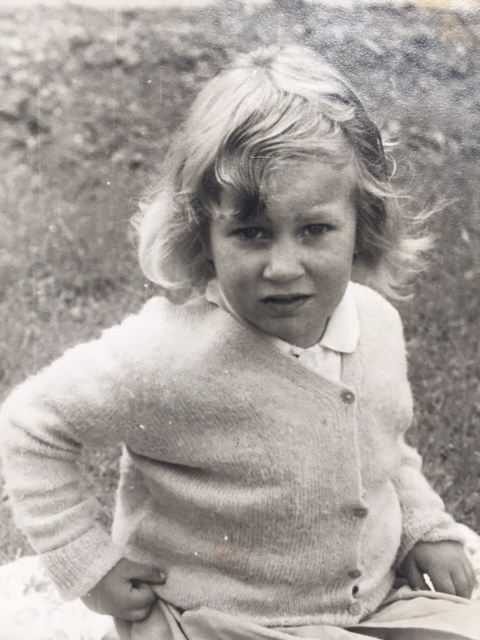 Mom, sitting in the back garden as a young girl (circa 1953)